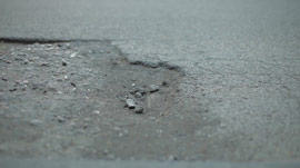 hdri-hub-ftg-00032-car-driving-pothole-300617873.JPG
