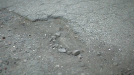 hdri-hub-ftg-00035-car-driving-pothole-300617876.JPG